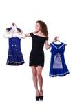 Frau, die versucht, Kleid zu wählen Stockbild