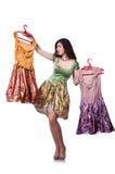 Frau, die versucht, Kleid zu wählen Lizenzfreie Stockfotos