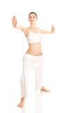 Frau, die Yogaübung tut Stockfotografie