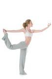 Frau, die Yoga, Lord der Tanz-/Natarajasanahaltung tut Stockbild