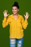Frau, die zehn Finger zeigt Lizenzfreie Stockfotografie