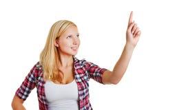 Frau, die Zeigefinger hochhält Stockbild