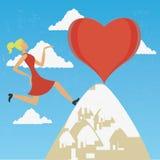Frau, die zur Spitze der Liebe klettert Lizenzfreie Stockbilder