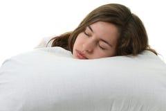 Frau in einem Bett Stockbild