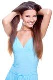 Frau in einem blauen Kleid Stockbilder