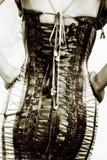 Frau in einem Korsett lizenzfreie stockfotografie