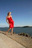 Frau in einem roten Kleid Stockbild