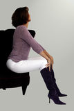 Frau in einem Stuhl Stockfotos
