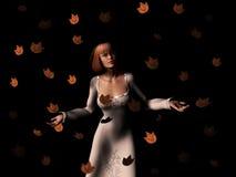 Frau in einem Sturm der Blätter Lizenzfreies Stockfoto