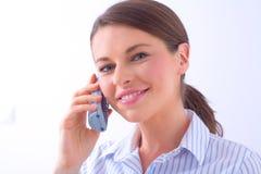 Frau an einem Telefon Stockfotografie