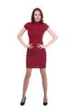 Frau in einem wenigen roten Kleid auf weißem Hintergrund Lizenzfreies Stockfoto