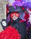 Frau in einer venetianischen Verkleidung Stockbilder