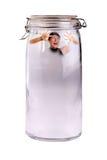 Frau eingeschlossen in einem Glas lizenzfreie stockfotos