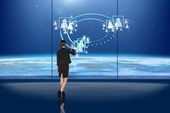 Frau am Fenster Lizenzfreie Stockfotos