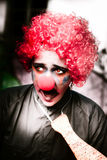 Frau Frightened The Scared Clown Stockbild
