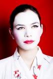 Frau gekleidet als Geisha Lizenzfreie Stockfotos