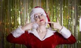 Frau gekleidet als Weihnachtsmann Lizenzfreie Stockfotografie