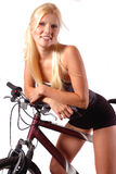 Frau gesessen auf Fahrrad Stockfotos