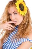Frau in gestreifter Weste und in Sonnenblume Lizenzfreie Stockbilder