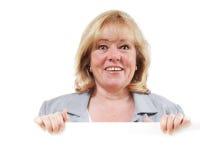 Frau hält Zeichen an stockbild