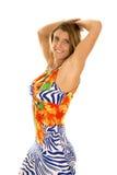 Frau hawaiische in der Kleiderhandobenliegenden Seite lizenzfreies stockbild