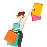 Frau hebt ihren Arm an und hängt Einkaufstaschen Stockbild