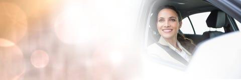Frau im Auto mit Übergangseffekt Stockfotografie
