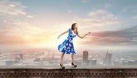 Frau im blauen Kleid Stockbilder