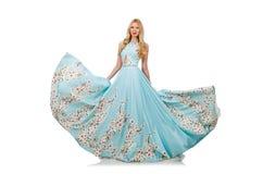 Frau im blauen langen Kleid mit Blume druckt Stockbild