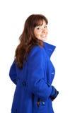Frau im blauen Mantel Stockfotografie