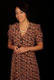 Frau im Blumenkleid Stockfotos