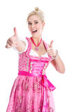Frau im Dirndl mit den Daumen oben Lizenzfreie Stockfotografie
