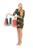Frau im dunkelgrünen Blumenkleid lokalisiert auf Weiß Lizenzfreie Stockfotos