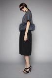 Frau im eleganten Kleid und in den hohen Absätzen Stockfotografie
