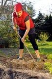 Frau im Garten Lizenzfreie Stockfotografie