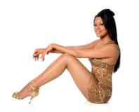 Frau im goldenen Kleid Stockbilder