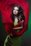 Frau im Grün Stockfotos