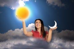 Frau im Himmel hält Mond und Sonne, Collage an Lizenzfreie Stockfotos