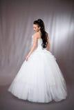 Frau im Hochzeitskleid. Stockbild