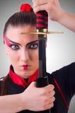 Frau im japanischen Kampfkunstkonzept Lizenzfreies Stockfoto