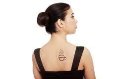 Frau im Kleid mit Kaffeesymbol auf ihr zurück. Lizenzfreie Stockfotos