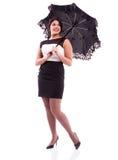 Frau im Kleid mit Regenschirm Stockbilder