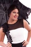 Frau im Kleid mit Regenschirm Stockfotos