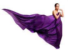 Frau im purpurroten langen Kleid Stockbilder
