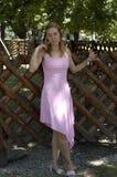 Frau im Rosa Stockbild