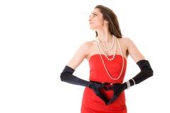 Frau im roten Kleid mit Innerem formte Hände Lizenzfreies Stockfoto