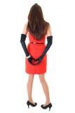 Frau im roten Kleid mit Innerem formte Hände Stockfotos