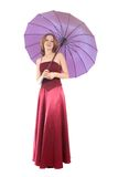 Frau im roten Kleid, mit Regenschirm Stockbilder