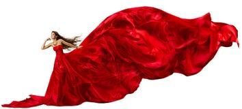 Frau im roten Kleid mit wellenartig bewegendem Gewebe des Fliegens Stockbilder