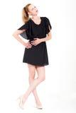 Frau im schwarzen Kleid Stockfotografie